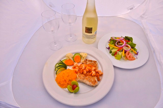 Juanitos Cantina dining with salad plate and wine bottle