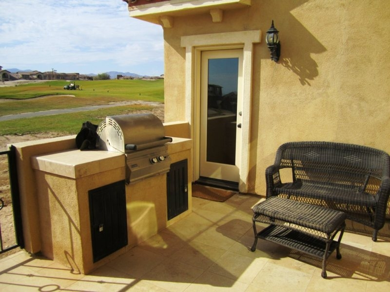 Patio with BBQ over looking golf course