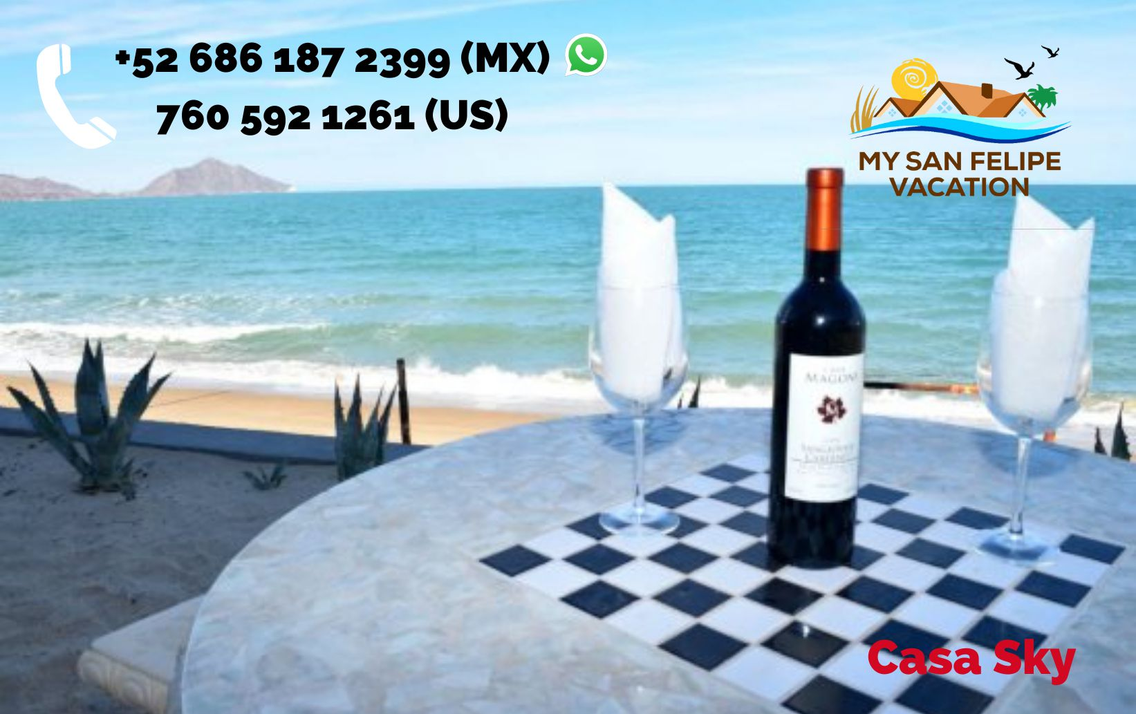 las palmas sky house patio table with wine and glasses over looking the sea